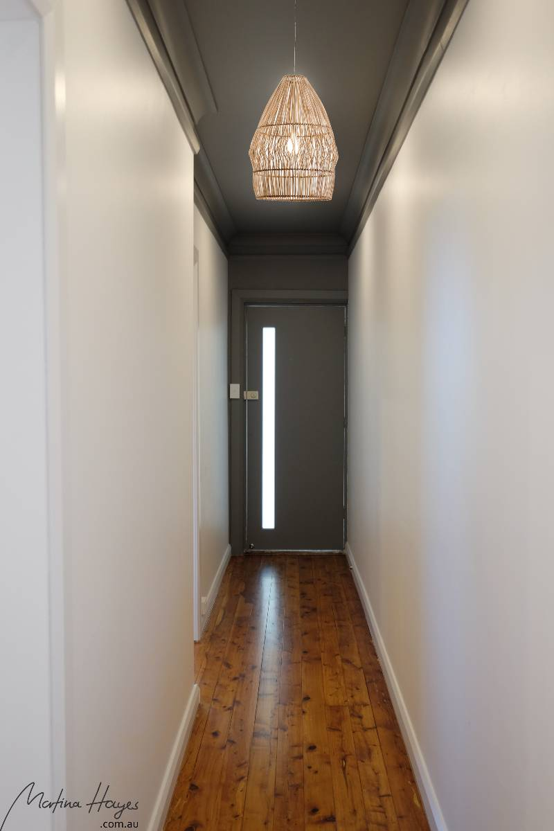 Entry hall with dark ceiling and white walls