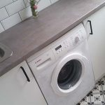 White laundry with patterned floor tiles
