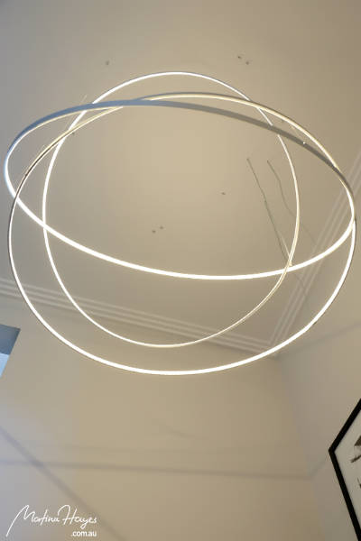 Pendant light made out of interlocking LED hoops