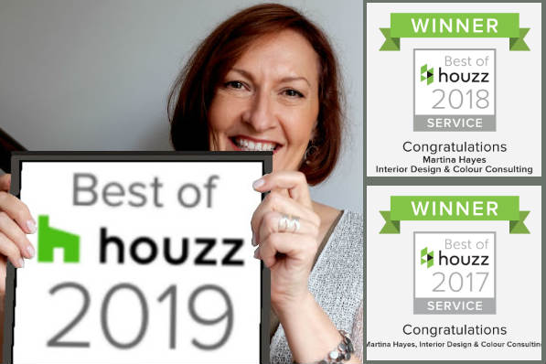 Smiling interior designer Martina Hayes holding up the Best of Houzz badge 2019